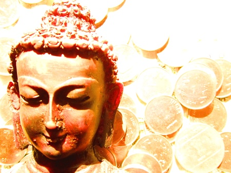 moksha: figure of lord Buddha with coins at background