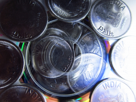 COINS UNDER A COMPACT DISC photo