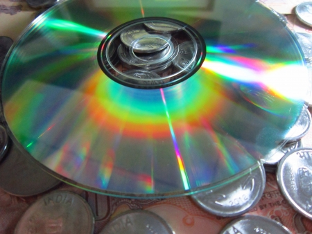 drawback: COMPACT DISC AND COINS Stock Photo