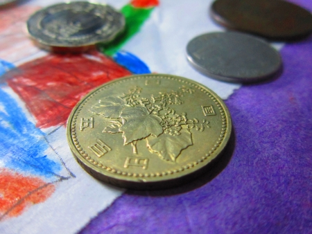 COINS IN COLOURFUL BACKGROUND photo
