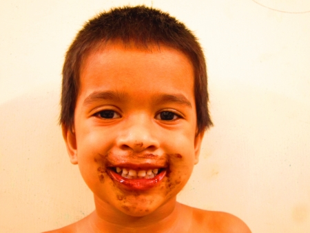 SMILING KID EATING CHOCOLATE Stock Photo - 15474208