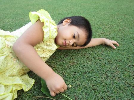 kid lying on green grass Stock Photo - 15478988