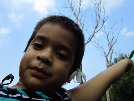 facing the camera: KID FACING CAMERA