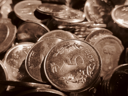 FIVE RUPEE COINS SHOT IN SEPIA MODE photo