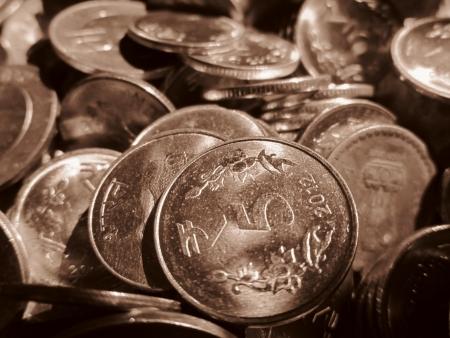 five rupee: FIVE RUPEE COINS SHOT IN SEPIA MODE