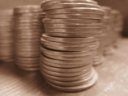 incertaininty: COINS STACK SHOT FROM FRONT-SEPIA MODE