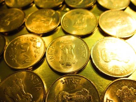 coins shot in golden color: coins shot in golden and vivid color