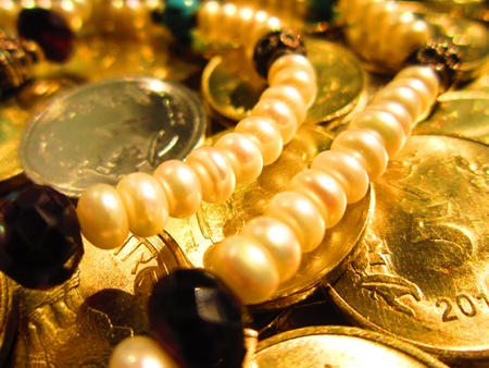 coins shot in golden color: coins shot in golden and vivid color with ornaments