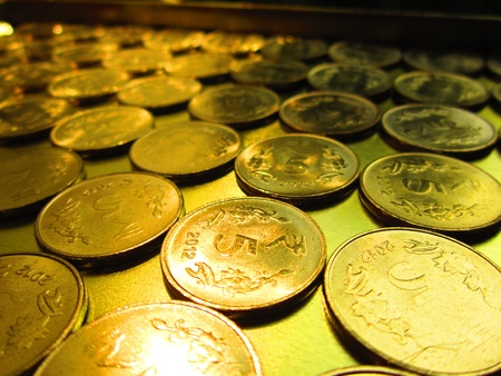 balanced budget: coins shot in golden and vivid color