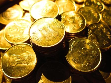 balanced budget: COINS SHOT IN GOLDEN COLOR
