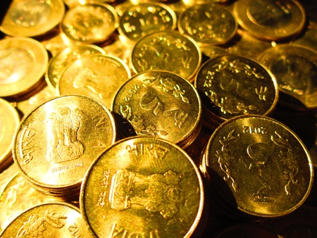 COINS SHOT IN GOLDEN COLOR Stock Photo - 15820601