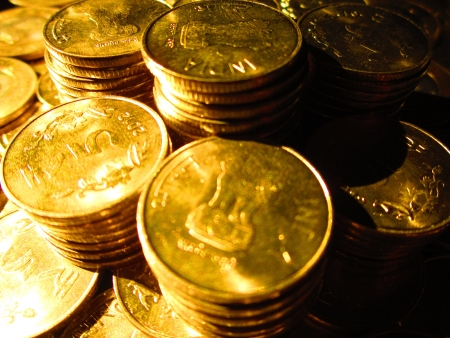 COINS SHOT IN GOLDEN COLOR Stock Photo - 15820591