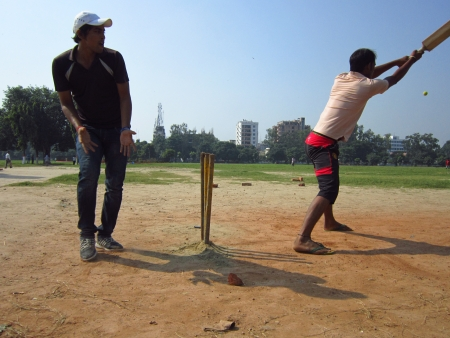 gandhi: PLAYING CRICKET.ACTIVITIES AT GANDHI MAIDAN, PATNA, BIHAR. SHOT AT MORNING HOURS ON 15.10.2012 AT  PATNA, BIHAR, INDIA Editorial