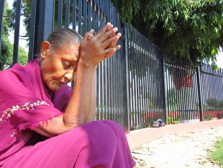 gandhi: WOMAN WITH FOLDED HANDS.ACTIVITIES AT GANDHI MAIDAN, PATNA, BIHAR. SHOT AT MORNING HOURS ON 15.10.2012 AT  PATNA, BIHAR, INDIA Editorial