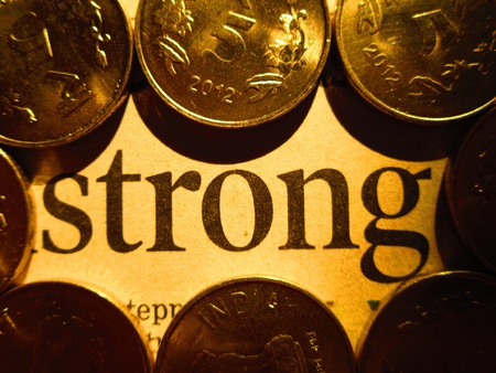 incertaininty: STRONG WORD WRITTEN AMONG COINS Stock Photo