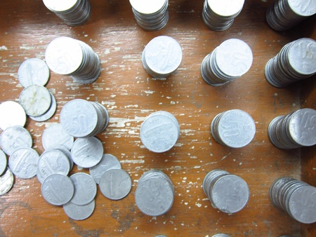 incertaininty: COINS STACKED AND DISPERSED