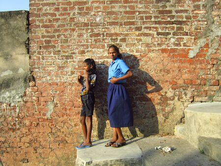 girls at at a ghat on river ganges. shot at kolkata, india on afternoon 22.10.12