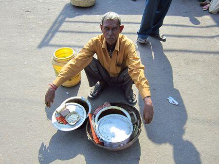 bihar: FOOD SELLER AT RAILWAY STATION. SHOT AT AFTERNOON HOURS AT JANJHA RAILWAY STATION ON 28.10.12 AT BIHAR, INDIA.