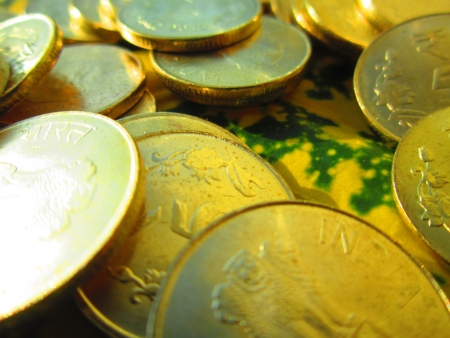 incertaininty: COINS SHOT ON COLORFUL LEAF Stock Photo