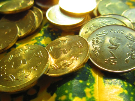 drawback: COINS SHOT ON COLORFUL LEAF Stock Photo