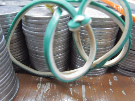balanced budget: COINS SHOT WITH RUBBER BAND