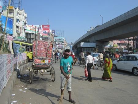 brooming: MAN BROOMING THE STREET. SHOT AT MORNING HOURS ON 30.10.12 AT PATNA, BIHAR, INDIA.