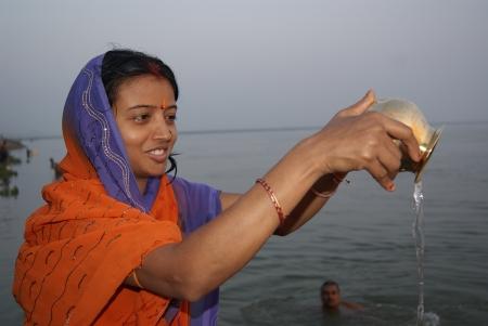 bihar: WOMAN PERFORMING MORNING GANGAPUJA AT GANGA RIVER. SHOT AT MORNING HOURS ON 15.06.11 AT PATNA, BIHAR, INDIA.