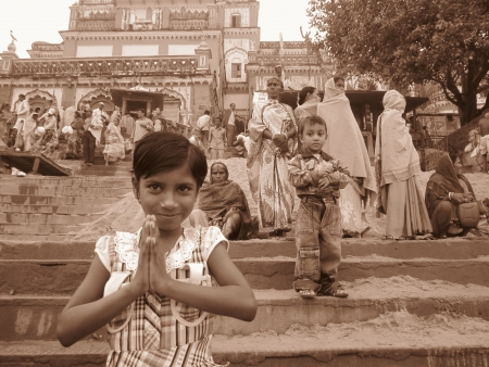 A CHILD SAYING NAMASTE AT KALIGHAT. SHOT AT MORNING HOURS ON 03 NOVEMBER 2012 AT  PATNA, BIHAR, INDIA