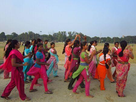 maidan: YOUNG GIRLS OF PATNA ENACTING STREET PLAY OR NUKKAD NATAK AT GANDHI MAIDAN. SHOT AT AFTERNOON HOURS ON 05 NOVEMBER 2012 AT  GANDHI MAIDAN, PATNA, BIHAR, INDIA, ASIA.
