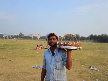 maidan: MAN SELLING COCONUT AT GANDHI MAIDAN. SHOT AT AFTERNOON HOURS ON 05 NOVEMBER 2012 AT  GANDHI MAIDAN, PATNA, BIHAR, INDIA, ASIA. Editorial