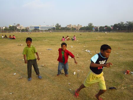gandhi: CHILDREN PLAYING AT GANDHI MAIDAN. SHOT AT AFTERNOON HOURS ON 05 NOVEMBER 2012 AT  GANDHI MAIDAN, PATNA, BIHAR, INDIA, ASIA.
