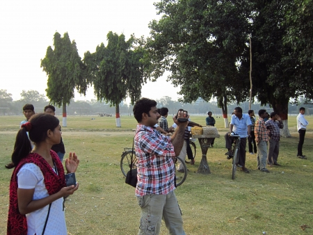 gandhi: PHOTOGRAPHER TAKING PICTURE OF STREET PLAY AT GANDHI MAIDAN. SHOT AT AFTERNOON HOURS ON 05 NOVEMBER 2012 AT  GANDHI MAIDAN, PATNA, BIHAR, INDIA, ASIA. Editorial