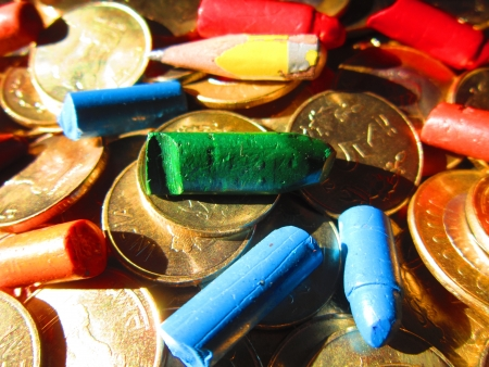 drawback: coins and colorful crayons Stock Photo