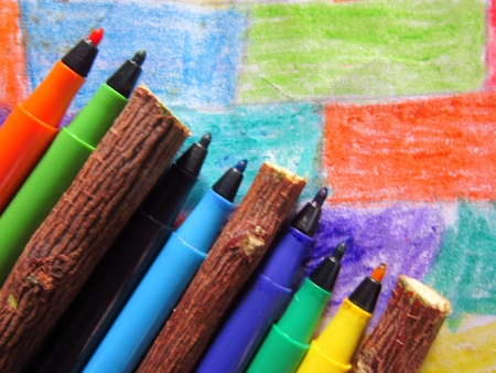 defining: colorful pens and sticks defining primary education Stock Photo