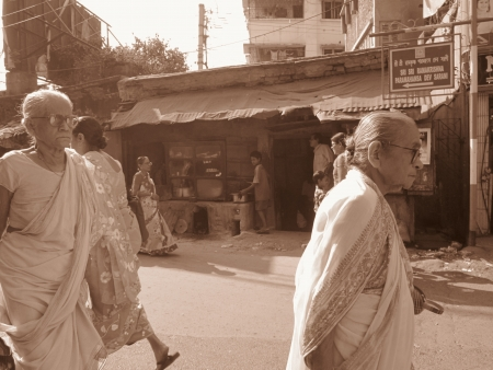 calcutta: OLD WOMEN WALKING ON ROAD.SHOT AT CALCUTTA, INDIA: AFTERNOON HOURS ON NOVEMBER 14,2012.