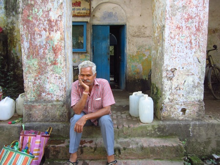 calcutta: THOUGHTFUL MAN WAITING FOR WATER. SHOT AT CALCUTTA, INDIA: AFTERNOON HOURS ON NOVEMBER 14,2012.