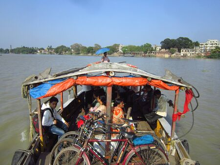calcutta: COMMUTERS TRAVELLING IN BOAT.SHOT AT CALCUTTA, INDIA: AFTERNOON HOURS ON NOVEMBER 14,2012.