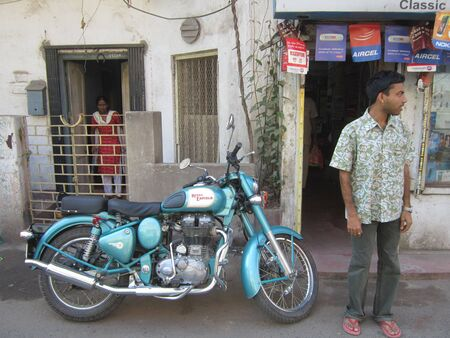 enfield: ENFIELD BIKE ON ROAD.SHOT AT CALCUTTA, INDIA: AFTERNOON HOURS ON NOVEMBER 15,2012.