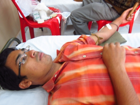 bloodshot: MAN DONATING BLOOD.SHOT AT CALCUTTA, INDIA: AFTERNOON HOURS ON NOVEMBER 18,2012. Editorial