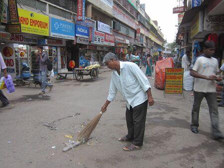 brooming: MAN BROOMING STREET.SHOT AT CALCUTTA, INDIA: AFTERNOON HOURS ON NOVEMBER 17,2012.