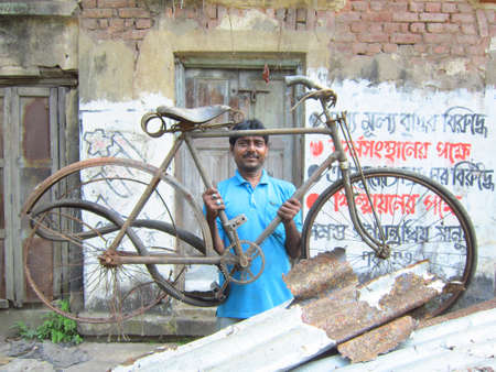 calcutta: MAN HOLDING OLD CYCLE AS JUNK.SHOT AT CALCUTTA, INDIA:AFTERNOON HOURS ON NOVEMBER 18,2012.