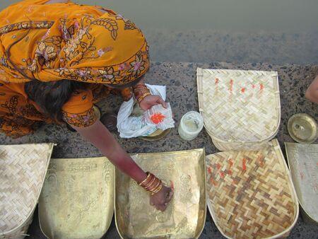 puja: WOMAN PERFORMING  CHATTH PUJA .SHOT AT PATNA, BIHAR, INDIA: MORNING HOURS ON NOVEMBER 19,2012.