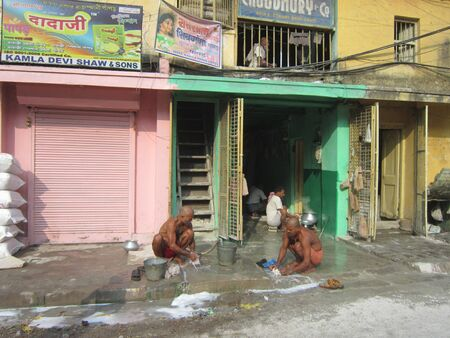 calcutta: PEOPLE WASHING CLOTHES AND BATHING.SHOT AT CALCUTTA INDIA: MORNING HOURS ON NOVEMBER 10,2012.