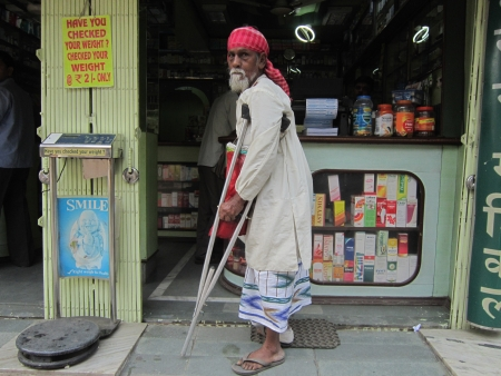 physically: PHYSICALLY CHALLENGED MAN BEGGING IN A SHOP.SHOT AT CALCUTTA INDIA: MORNING HOURS ON NOVEMBER 12,2012.