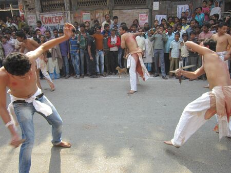 martyrdom: SIHA MUSLIMS FLAGELLATED THEMSELVES DURING MUHARRAM PROCESSION. SHOT AT AFTERNOON HOURS AT PATNA, BIHAR, INDIA ON 25.11.12.