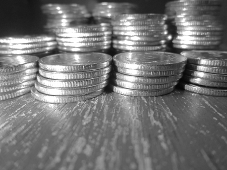 balanced budget: COINS STACK IN BLACK AND WHITE