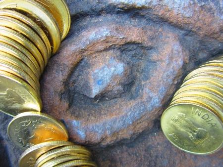 balanced budget: COINS SHOT OVER STONE
