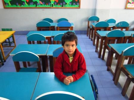 bihar: KID WAITING AT SCHOOL.SHOT AT PATNA, BIHAR INDIA:MORNING HOURS ON NOVEMBER 23,2012. Editorial
