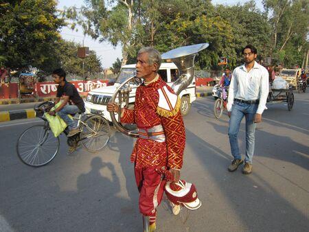 bihar: BANDPARTY MAN WALKING ON STREET.SHOT AT PATNA, BIHAR INDIA: AFTERNOON HOURS ON NOVEMBER 29,2012.