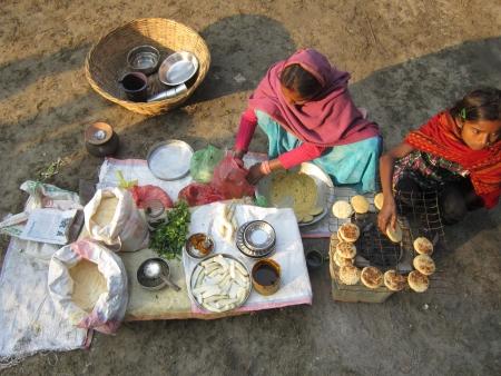 sonepur fair: WOMAN MAKING LITTI, A BIHAR FOOD.SHOT DURING MORNING HOURS ON 02.12.12 AT SONEPUR FAIR, SONEPUR, BIHAR, INDIA.